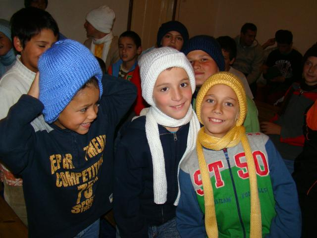 BOL boys as they received winter hats and scarfs
